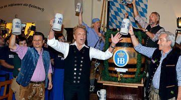 Siegfried and Hofbrauhaus Las Vegas Owners tap into the first keg of Oktoberfestbier during the 2016 kick off ceremony